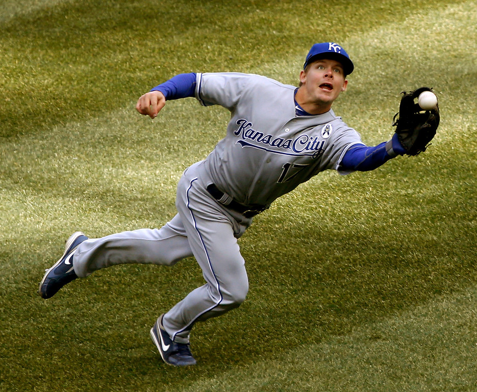 . Kansas City Royals second baseman Chris Getz is unable to catch a shallow fly ball off the bat of Chicago White Sox\'s Alexei Ramirez during the sixth inning of the White Sox\'s opening day baseball game Monday, April 1, 2013, in Chicago. (AP Photo/Charles Rex Arbogast)