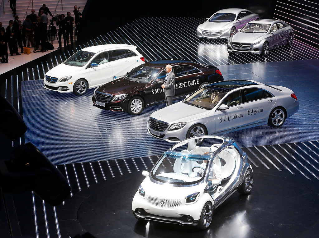 . A range of Mercedes and Smart cars is presented by CEO of Daimler AG Dieter Zetsche during the Mercedes-Benz Media Night at the 65th Frankfurt Auto Show in Frankfurt, Germany, Monday, Sept. 9, 2013. More than 1,000 exhibitors will show their products to the public from Sept. 12 through Sept.22, 2013. (AP Photo/Michael Probst)