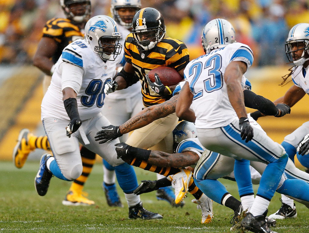 . Antonio Brown #84 of the Pittsburgh Steelers tries to get past the tackle of Nick Fairley #98 of the Detroit Lions at Heinz Field on November 17, 2013 in Pittsburgh, Pennsylvania.  (Photo by Gregory Shamus/Getty Images)