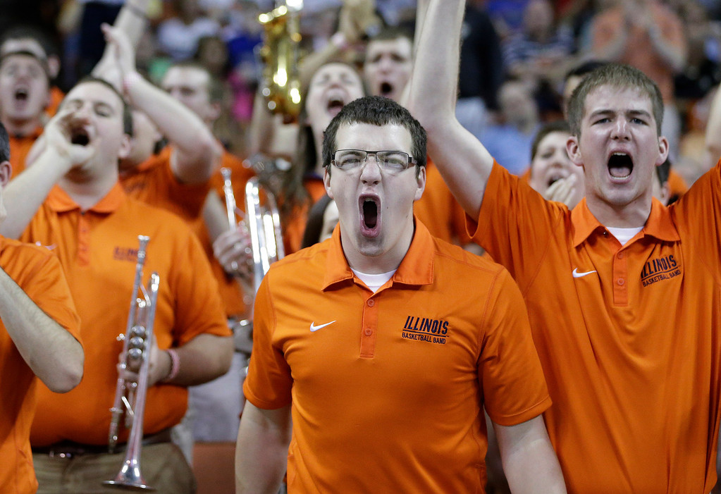 . Illinois band members cheer during the first half of a second-round game of the NCAA college basketball tournament between Illinois and Colorado, Friday, March 22, 2013, in Austin, Texas.  (AP Photo/David J. Phillip)