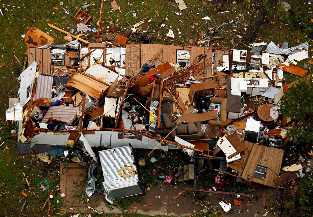 . This aerial photo shows a home with extensive damage caused by Wednesday\'s tornado in Granbury, Texas on Thursday, May 16, 2013. (AP Photo/The Dallas Morning News, G.J.McCarthy)