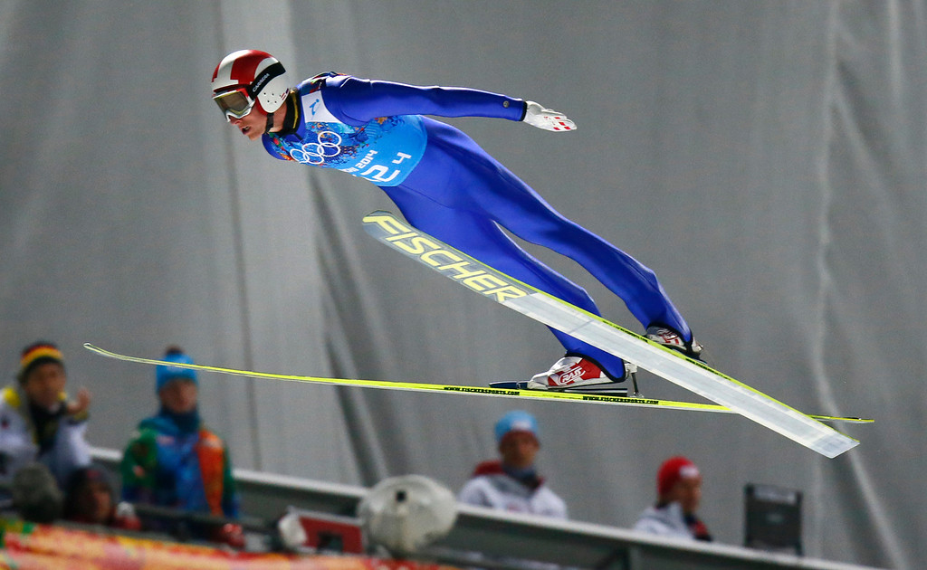. Austria\'s Gregor Schlierenzauer makes his trial jump during the ski jumping large hill team competition at the 2014 Winter Olympics, Monday, Feb. 17, 2014, in Krasnaya Polyana, Russia. (AP Photo/Dmitry Lovetsky)