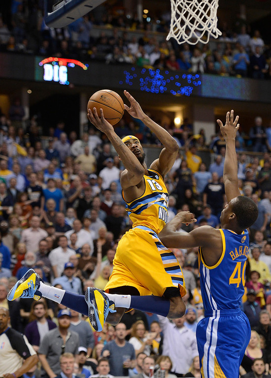 . DENVER, CO. - APRIL 20: Denver Nuggets small forward Corey Brewer (13) put up a shot against Golden State Warriors small forward Harrison Barnes (40) in the second quarter. The Denver Nuggets took on the Golden State Warriors in Game 1 of the Western Conference First Round Series at the Pepsi Center in Denver, Colo. on April 20, 2013. (Photo by John Leyba/The Denver Post)