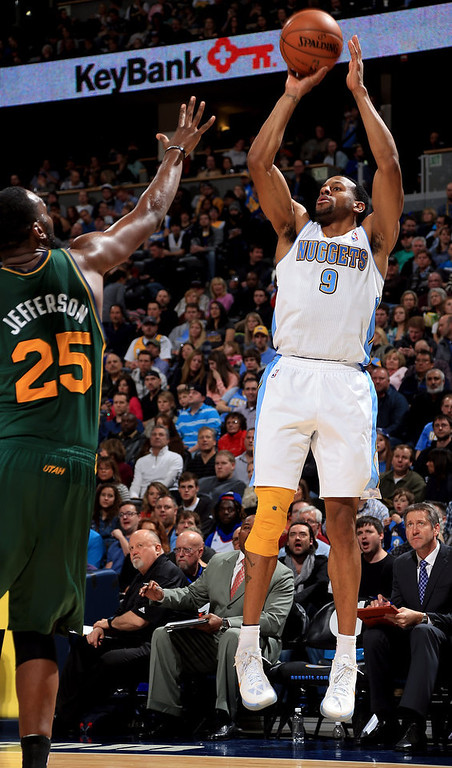 . Andre Iguodala #9 of the Denver Nuggets takes a shot over Al Jefferson #25 of the Utah Jazz at the Pepsi Center on January 5, 2013 in Denver, Colorado. (Photo by Doug Pensinger/Getty Images)