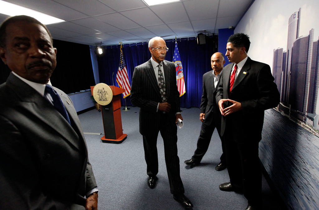 . Detroit Mayor Dave Bing, second from left, leaves a news conference in Detroit, Thursday, July 18, 2013. State-appointed emergency manager Kevyn Orr asked a federal judge permission to place Detroit into Chapter 9 bankruptcy protection Thursday. (AP Photo/Paul Sancya)