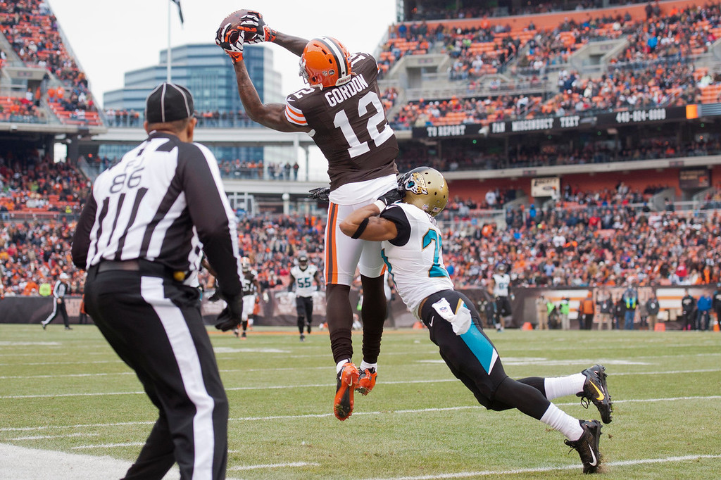 . Wide receiver Josh Gordon #12 of the Cleveland Browns catches a pass under pressure from cornerback Dwayne Gratz #27 of the Jacksonville Jaguars during the first half at FirstEnergy Stadium on December 1, 2013 in Cleveland, Ohio. (Photo by Jason Miller/Getty Images)