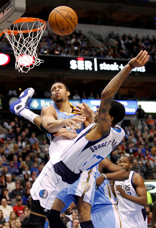 . Dallas Mavericks guard Chris Douglas-Roberts (R) is fouled by Denver Nuggets center JaVale McGee during the first half of their NBA basketball game in Dallas, Texas, December 28, 2012.  REUTERS/Mike Stone