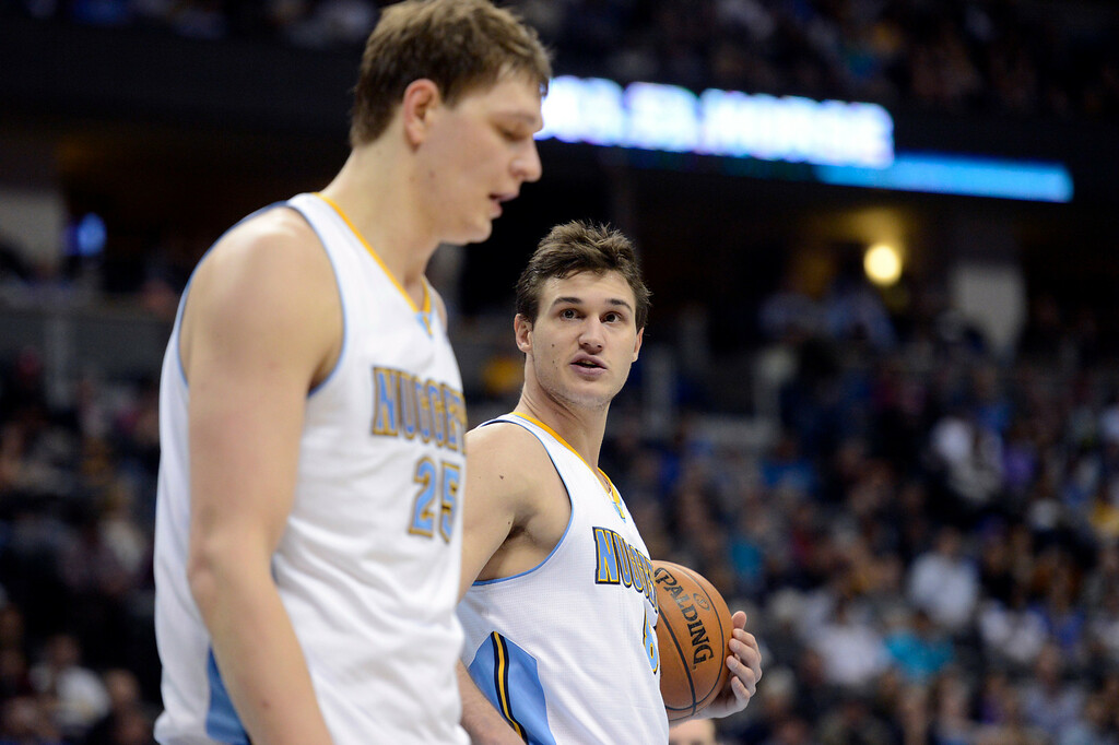 . DENVER, CO. - JANUARY 28: Denver Nuggets small forward Danilo Gallinari (8) gives a little pep talk to Denver Nuggets center Timofey Mozgov (25) during the fourth quarter January 28, 2013 at Pepsi Center. The Denver Nuggets defeated the Indiana Pacers 102-101 in NBA Action. (Photo By John Leyba / The Denver Post)
