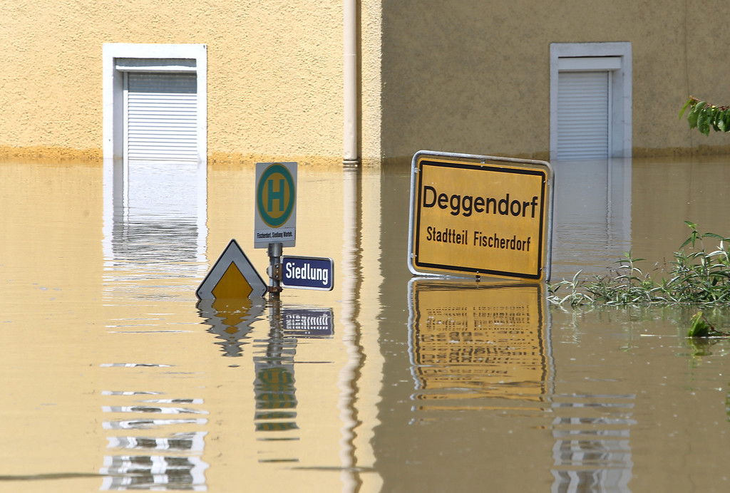 . A place name sign submerges in the floods in Deggendorf, southern Germany, on June 5, 2013.     AFP PHOTO / KARL-JOSEF HILDENBRAND / /AFP/Getty Images