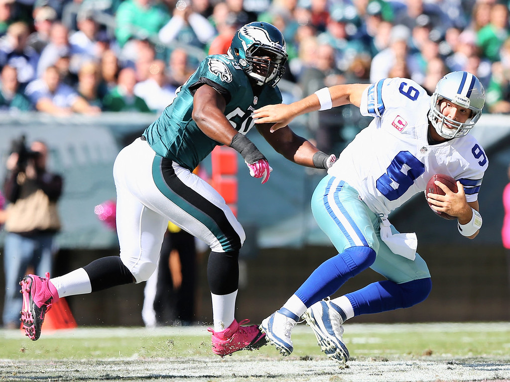 . Tony Romo #9 of the Dallas Cowboys is sacked by DeMeco Ryans #59 of the Philadelphia Eagles on October 20, 2013 at Lincoln Financial Field in Philadelphia, Pennslyvania.  (Photo by Elsa/Getty Images)