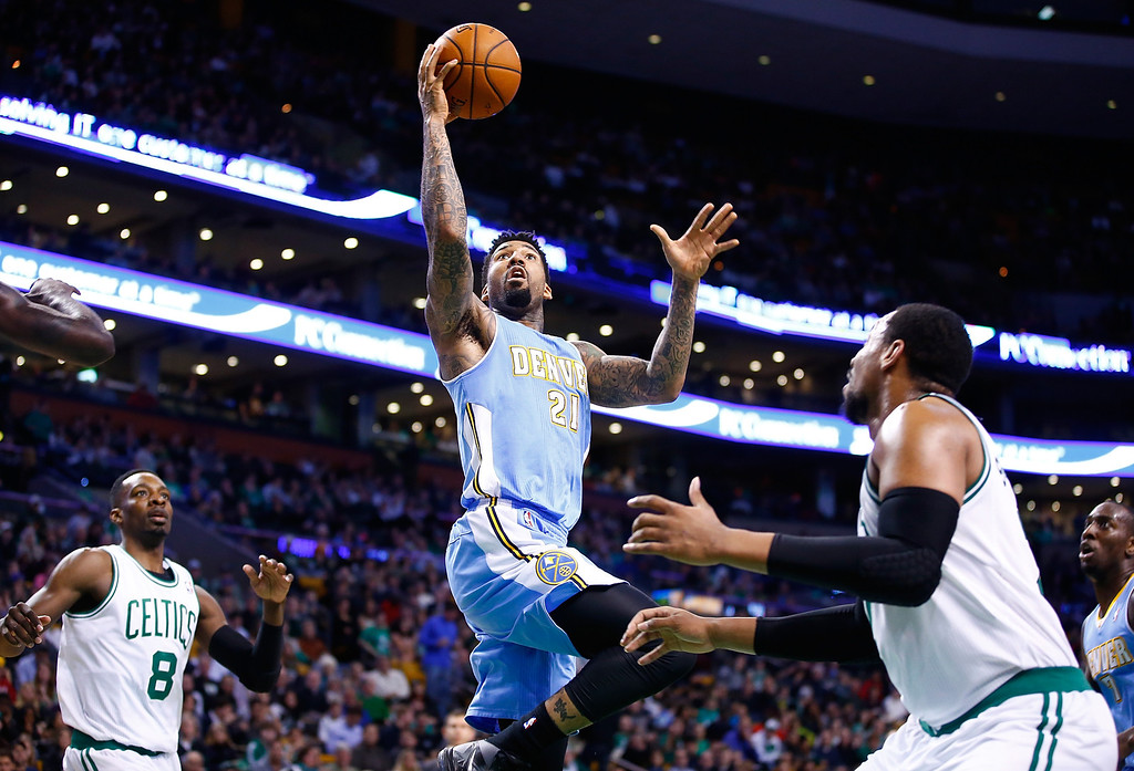 . BOSTON, MA - DECEMBER 06:  Wilson Chandler #21 of the Denver Nuggets drives to the basket in the second half in front of Jared Sullinger #7 of the Boston Celtics during the game at TD Garden on December 6, 2013 in Boston, Massachusetts.  (Photo by Jared Wickerham/Getty Images)