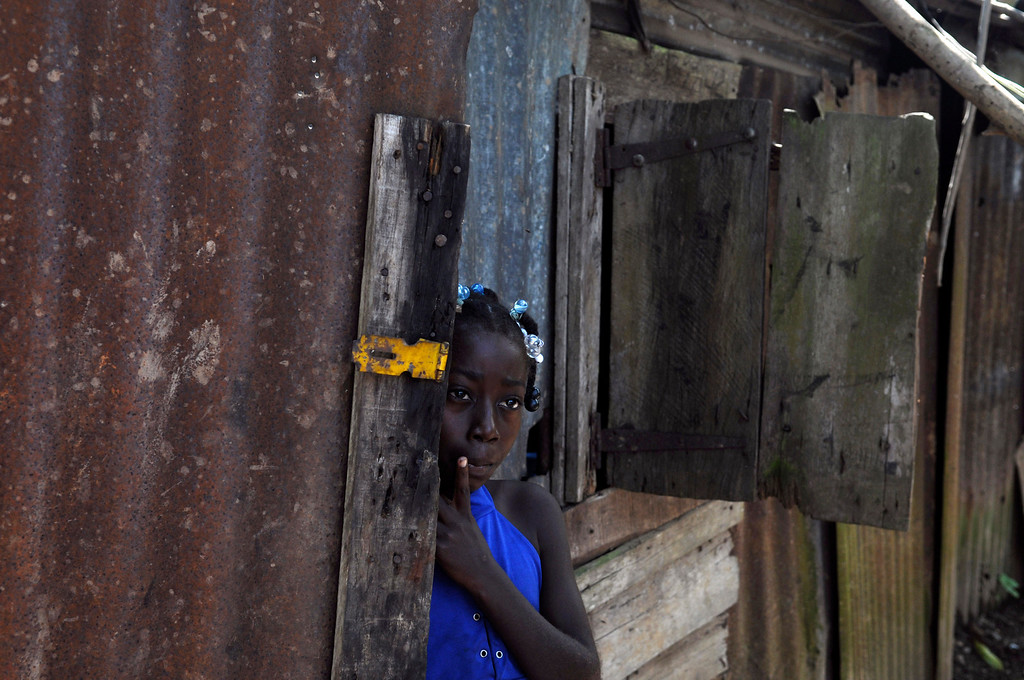 . In this Sept. 30, 2013 photo, Maria Julia Deguis, 10, looks out from her home in Los Jovillos village, known as a batey, in the Monte Plata province of the Dominican Republic. Maria, like with her mother and brother, is of Haitian descent and was born in the D.R., but she may lose her citizenship, and the rights that go along with it, because of a recent Constitutional Court decision. (AP Photo/Manuel Diaz)