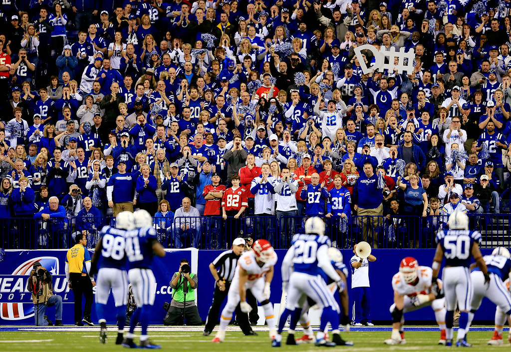 . INDIANAPOLIS, IN - JANUARY 04: Fans cheer during a Wild Card Playoff game between the Indianapolis Colts and the Kansas City Chiefs at Lucas Oil Stadium on January 4, 2014 in Indianapolis, Indiana.  (Photo by Rob Carr/Getty Images)