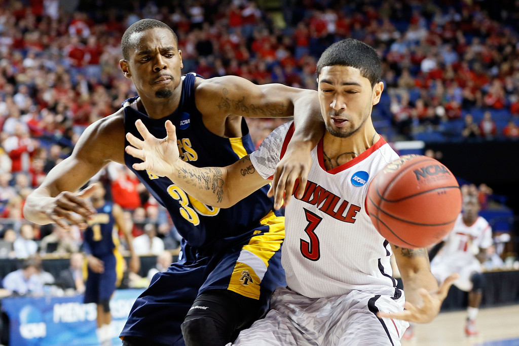 . LEXINGTON, KY - MARCH 21:  Peyton Siva #3 of the Louisville Cardinals and Lamont Middleton #30 of the North Carolina A&T Aggies fight for the loose ball during the second round of the 2013 NCAA Men\'s Basketball Tournament at the Rupp Arena on March 21, 2013 in Lexington, Kentucky.  (Photo by Kevin C. Cox/Getty Images)