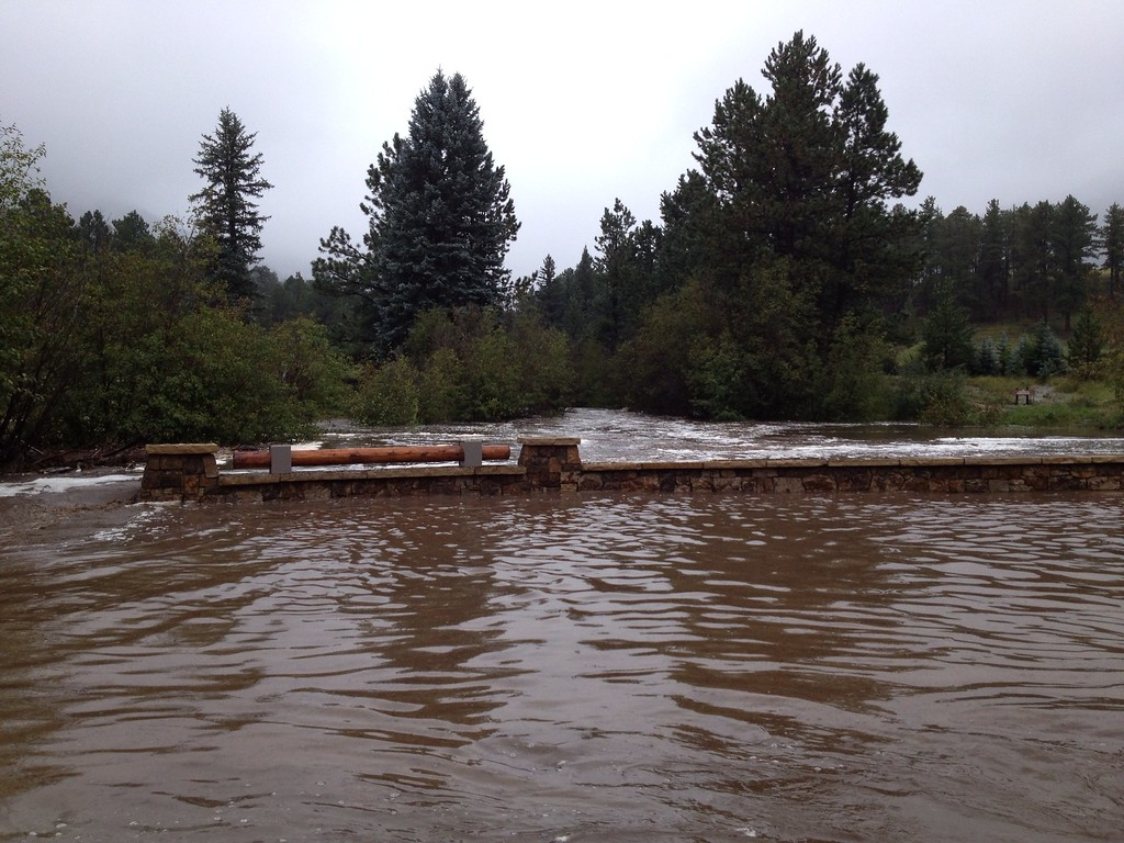 . Aspen Brook floods blocking the entrance to YMCA Camp of the Rockies. Photo by Mark Konings