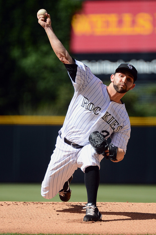 . Tyler Chatwood #32 of the Colorado Rockies pitches against the New York Mets in the first inning of the game at Coors Field on June 27, 2013 in Denver, Colorado. Photo by Garrett W. Ellwood/Getty Images)