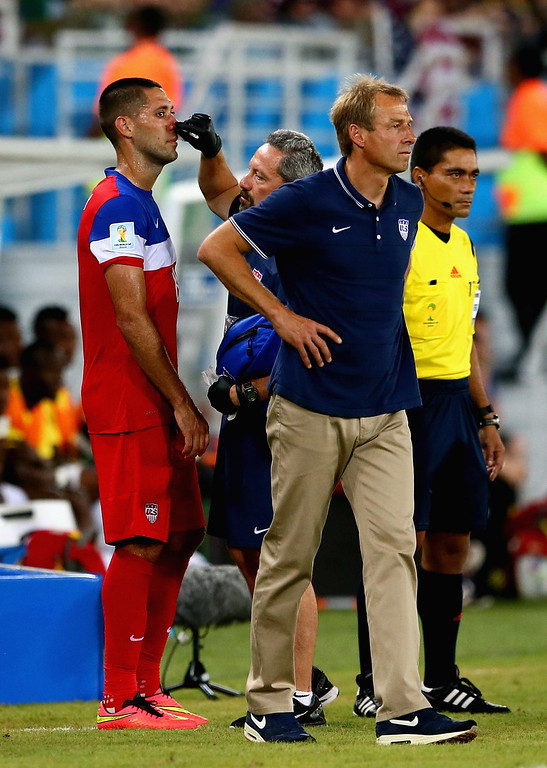 . Clint Dempsey of the United States receives treatment as head coach Jurgen Klinsmann looks on during the 2014 FIFA World Cup Brazil Group G match between Ghana and the United States at Estadio das Dunas on June 16, 2014 in Natal, Brazil.  (Photo by Kevin C. Cox/Getty Images)