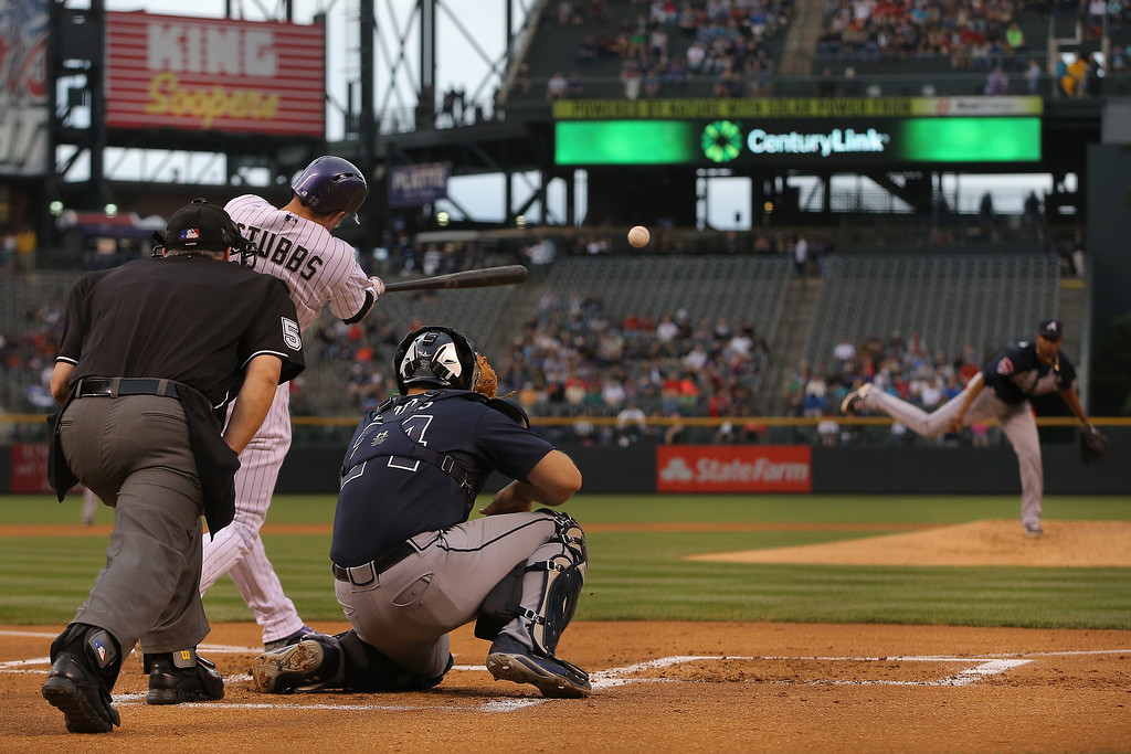 . Drew Stubbs #13 of the Colorado Rockies hits an RBI double off of starting pitcher Julio Teheran #49 of the Atlanta Braves to score Josh Rutledge #14 of the Colorado Rockies and take a 1-0 lead in the first inning at Coors Field on June 11, 2014 in Denver, Colorado.  (Photo by Doug Pensinger/Getty Images)