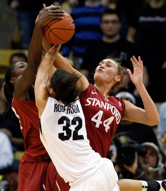. Stanford guard Amber Orrange, left, joins forward Joslyn Tinkle, right, to block a shot by Colorado forward Arielle Roberson in the first half of an NCAA women\'s college basketball game in Boulder, Colo., on Friday, Jan. 4, 2013. (AP Photo/David Zalubowski)