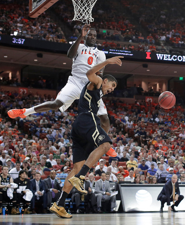 . Illinois\' Sam McLaurin (0) crashes into Colorado\'s Josh Scott, right, during the first half of a second-round game of the NCAA college basketball tournament Friday, March 22, 2013, in Austin, Texas.  (AP Photo/Eric Gay)