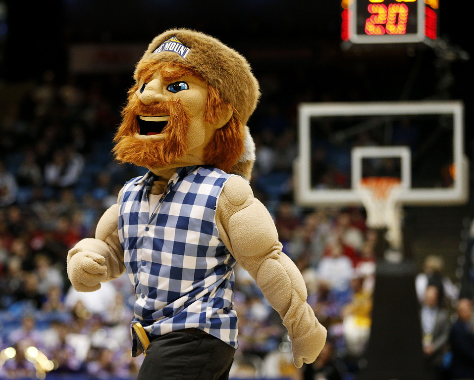 . The Mount St. Mary\'s Mountaineers mascot, Emmit S. Burg, performs against the Albany Great Danes during the first round of the 2014 NCAA Men\'s Basketball Tournament at at University of Dayton Arena on March 18, 2014 in Dayton, Ohio.  (Photo by Gregory Shamus/Getty Images)