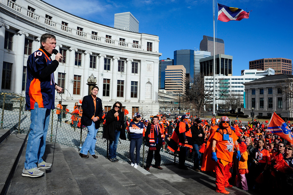 . Governor John Hickenlooper speaks to fans during a rally to send off the Denver Broncos, at the City and County Building in Denver, Colorado, Sunday, January 26, 2014. The noon rally brought out scores of supporters and included an appearance by Governor John Hickenlooper and Denver Mayor Michael Hancock.  (Photo By Brenden Neville / Special to The Denver Post)