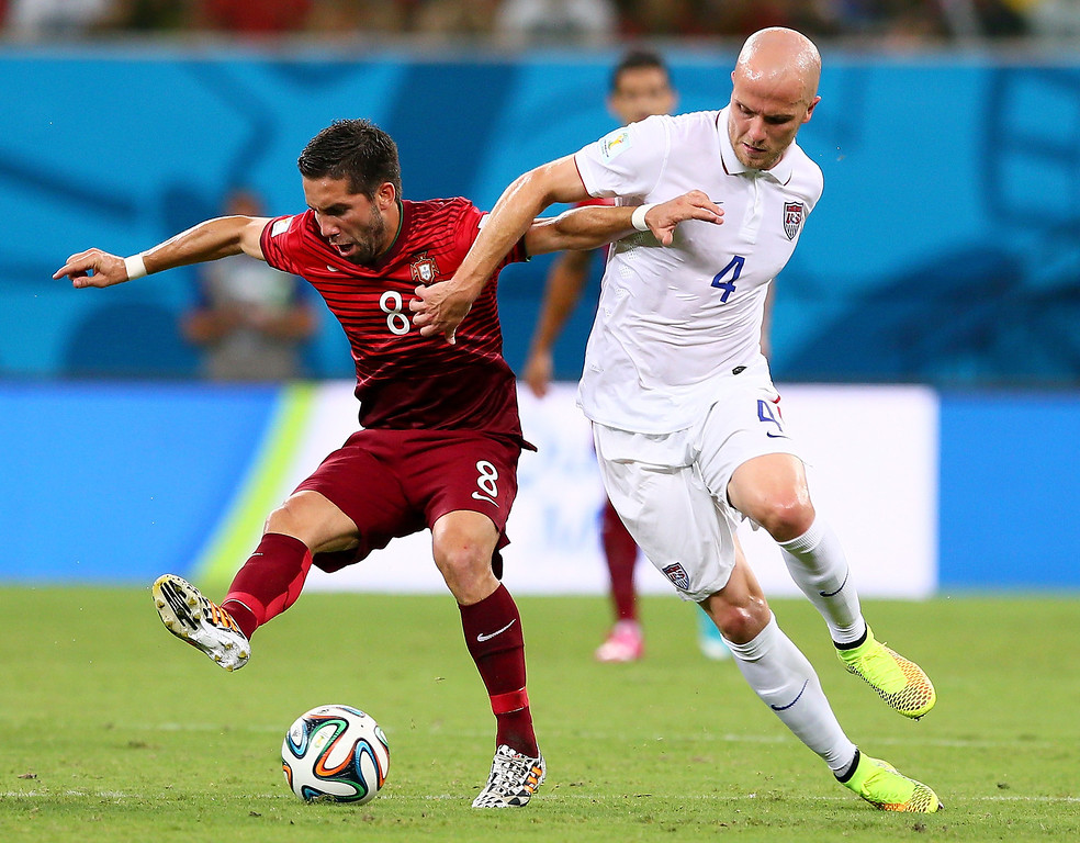 . Joao Moutinho of Portugal and Michael Bradley of the United States compete for the ball during the 2014 FIFA World Cup Brazil Group G match between the United States and Portugal at Arena Amazonia on June 22, 2014 in Manaus, Brazil.  (Photo by Kevin C. Cox/Getty Images)