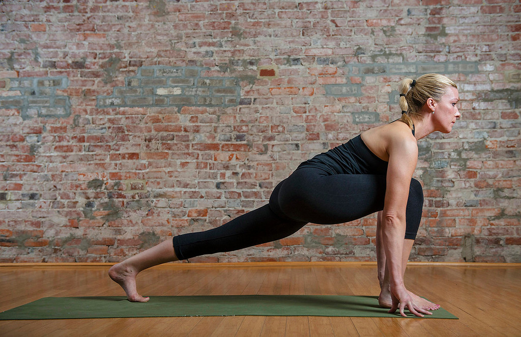 . Sun salutation, left to right: 9) Step forward from downward facing dog to the front of your mat.  (Photo for The Washington Post by Amanda Voisard.)