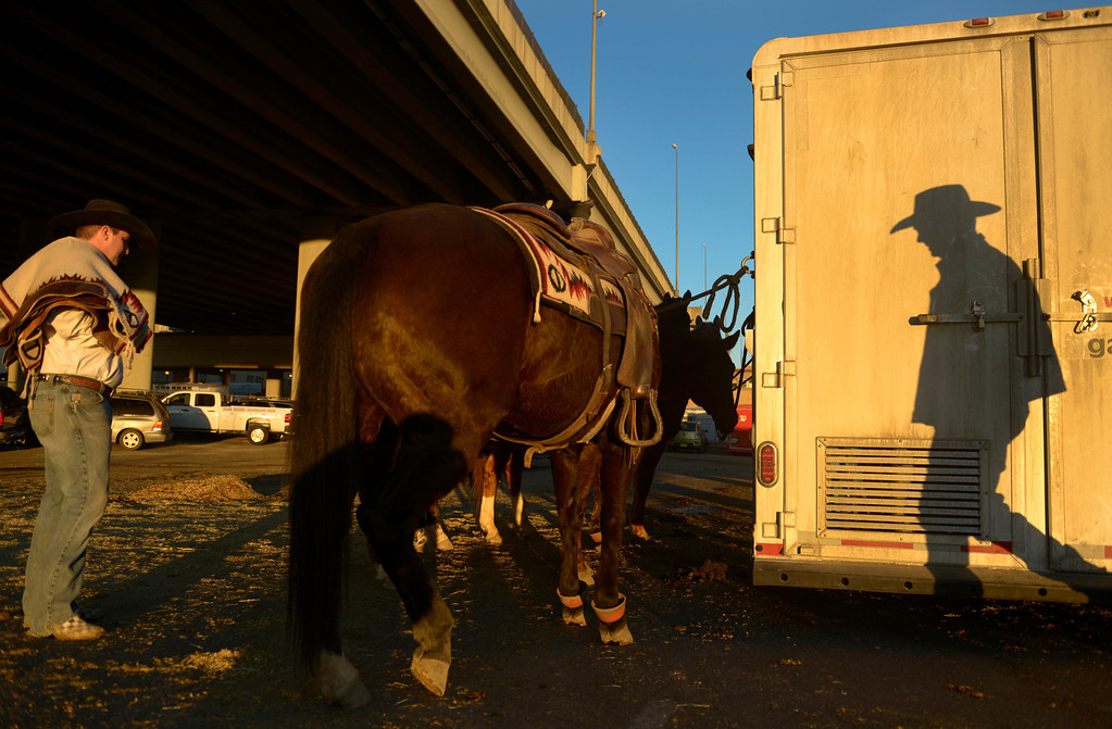 . DENVER, CO- JANUARY 27:  Gary Rempel, right, packs up his trailer after the stock show.  Rempel, of Great Falls, Montana is the pick up man for the riders in the rodeo.  The final day of the 2013 National Western Stock show was Sunday, January 27th.  One of the big events for the day was the PRCA Pro Rodeo finals in the Coliseum.  The event featured bareback riding, steer wrestling, team roping, saddle bronc riding, tie down roping, barrel racing and bull riding.  (Photo By Helen H. Richardson/ The Denver Post)