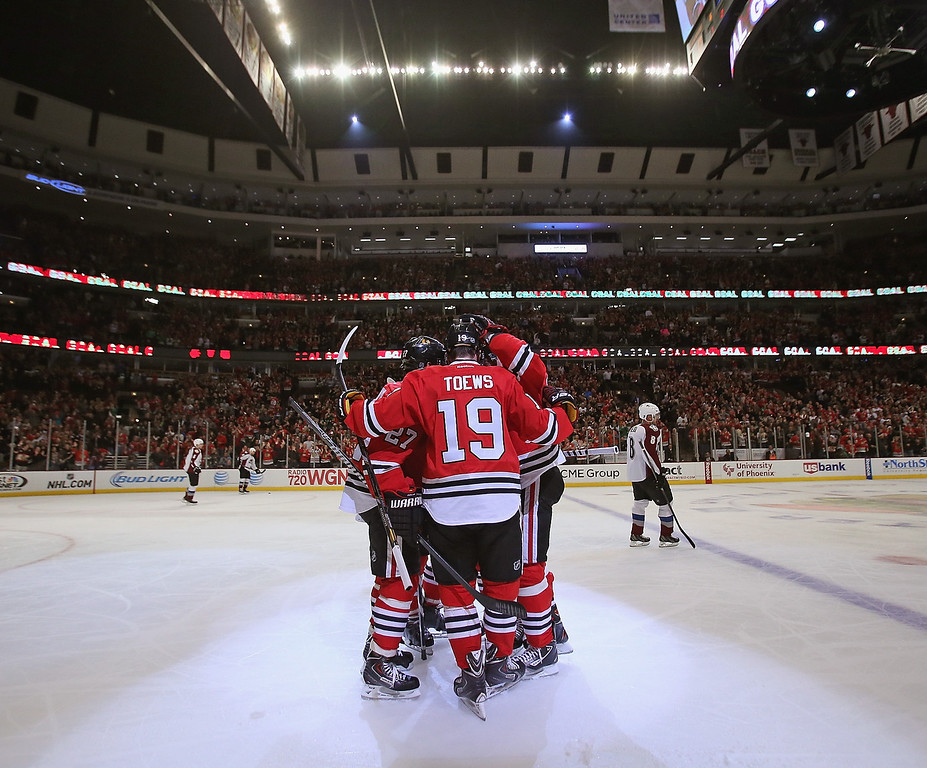 . CHICAGO, IL - DECEMBER 27: Jonathan Toews #19 of the Chicago Blackhawks celebrates a second period goal with teammates against the Colorado Avalanche at the United Center on December 27, 2013 in Chicago, Illinois. (Photo by Jonathan Daniel/Getty Images)