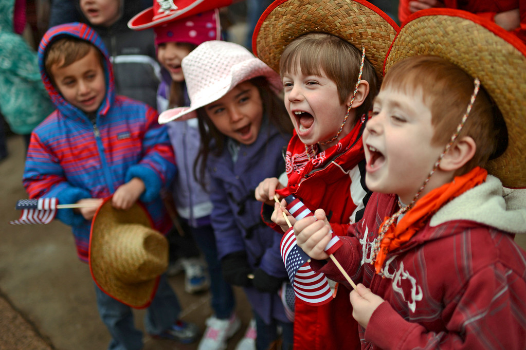 . From left, Tanner Laycobs, 5, Isla George, 5, Danielle Doida, 4, Charlie Feldman, 5, and Scotty Weiner, 5, celebrate 107th National Western Stock Show Kick-Off Parade at Downtown Denver on Thursday, Denver, CO, January 10, 2013.  Hyoung Chang, The Denver Post