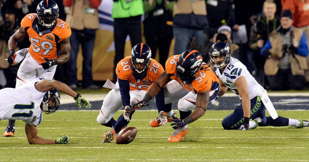 . Denver Broncos outside linebacker Nate Irving (56) and Denver Broncos free safety Mike Adams (20) go for a fumble that turned out to be an incomplete pass during the first quarter.  The Denver Broncos vs the Seattle Seahawks in Super Bowl XLVIII at MetLife Stadium in East Rutherford, New Jersey Sunday, February 2, 2014. (Photo by Hyoung Chang//The Denver Post)