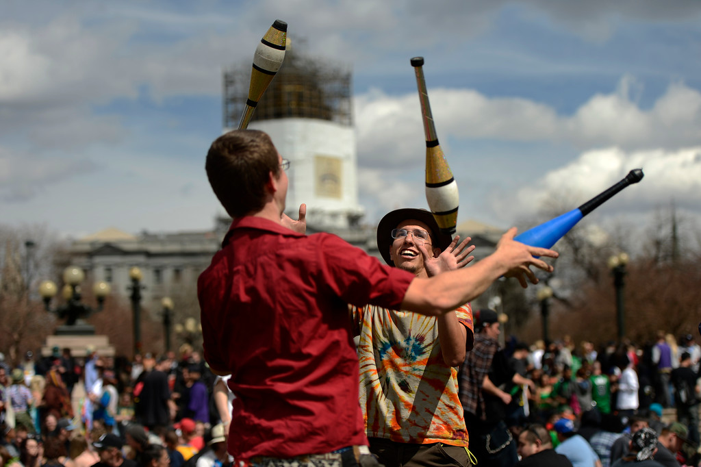 . Michael Cercone and Richard Deanda juggling at the annual 420 Rally at Civic Center Park in downtown Denver April 20, 2013 Denver, Colorado. (Photo By Joe Amon/The Denver Post)