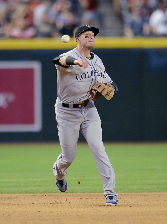 . Troy Tulowitzki #2 of the Colorado Rockies makes a throw to first base against the Arizona Diamondbacks in the third inning at Chase Field on April 28, 2014 in Phoenix, Arizona.  (Photo by Norm Hall/Getty Images)
