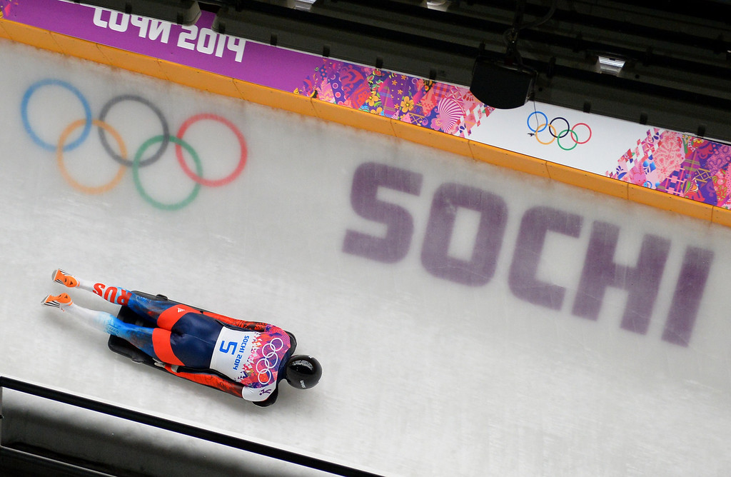 . Russia\'s Alexander Tretiakov competes to win gold in the Men\'s Skeleton Heat 4 and final run at the Sanki Sliding Center in Rosa Khutor during the Sochi Winter Olympics on February 15, 2014.   LEON NEAL/AFP/Getty Images