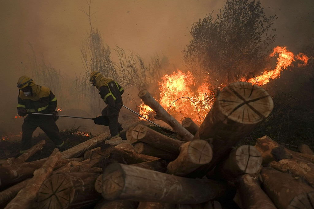 . Firefighters battle a blaze in Lousame, near A Coruna, on August 29, 2013. Spain is prone to forest fires in summer because of soaring temperatures, strong winds and dry vegetation. Last year wildfires destroyed some 150,000 hectares of land in Spain from January to July, after one of the driest winters on record.   PEDRO ARMESTRE/AFP/Getty Images