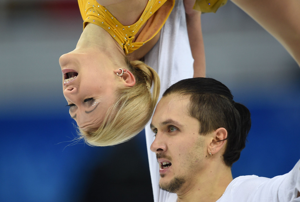 . Russia\'s Tatiana Volosozhar and Russia\'s Maxim Trankov perform their Figure Skating Pairs Free Program at the Iceberg Skating Palace during the Sochi Winter Olympics on February 12, 2014.   DAMIEN MEYER/AFP/Getty Images