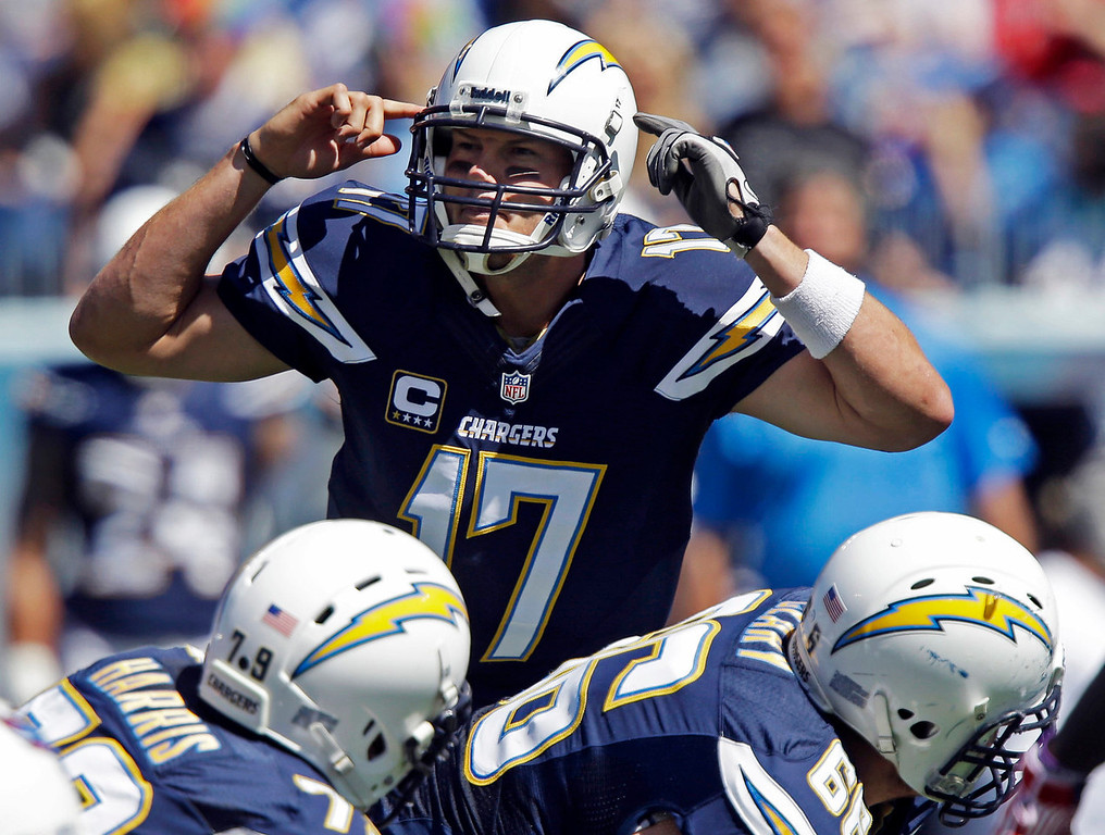 . San Diego Chargers quarterback Philip Rivers (17) calls a play at the line of scrimmage during the first quarter of an NFL football game against the Tennessee Titans on Sunday, Sept. 22, 2013, in Nashville, Tenn. (AP Photo/Wade Payne)