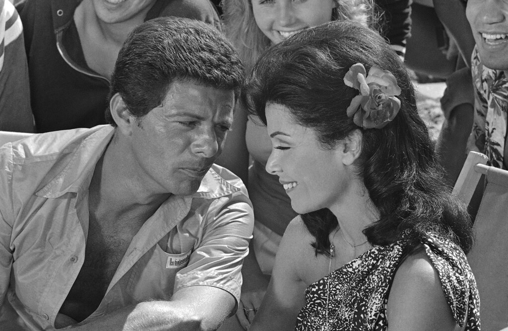 . Working together again after a separation of ten years Frankie Avalon and Annette Funicello chat during a break in the filming of another beach movie in Los Angeles, Aug. 26, 1977.  (AP Photo/Jeff Robbins)