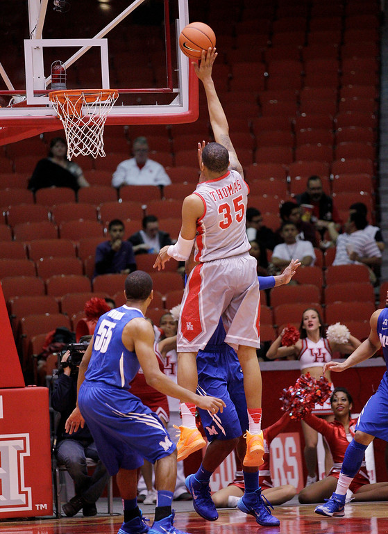 . Houston\'s forward TaShawn Thomas (35) shoots over Memphis\' Geron Johnson (55) during the first half of an NCAA college basketball game, Thursday, Feb. 27, 2014, in Houston. (AP Photo/Bob Levey)