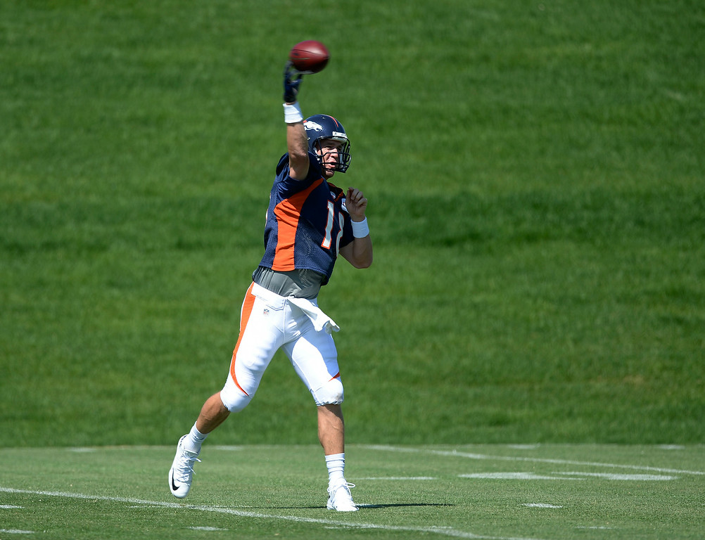 . Denver Broncos quarterback Peyton Manning (18) throws a pass during practice at the Denver Broncos 2014 training camp August 11, 2014 at Dove Valley. (Photo by John Leyba/The Denver Post)
