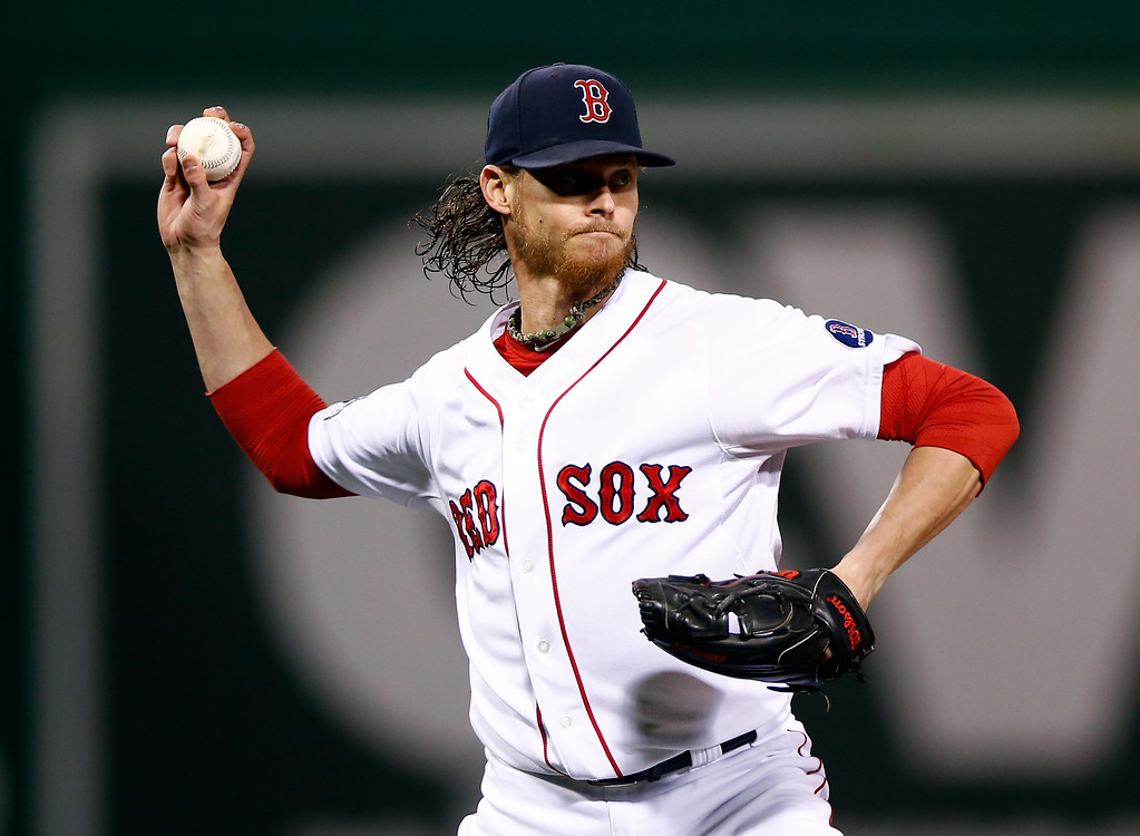 . BOSTON, MA - OCTOBER 19:  Clay Buchholz #11 of the Boston Red Sox throws out to first base after a grounder hit by Austin Jackson #14 of the Detroit Tigers to end the top of the second inning against the Detroit Tigers during Game Six of the American League Championship Series at Fenway Park on October 19, 2013 in Boston, Massachusetts.  (Photo by Jared Wickerham/Getty Images)