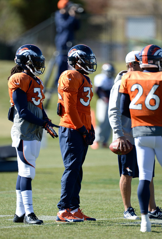 . Denver Broncos strong safety Duke Ihenacho (33) looks on during drills at practice November 6, 2013 at Dove Valley. (Photo by John Leyba/The Denver Post)