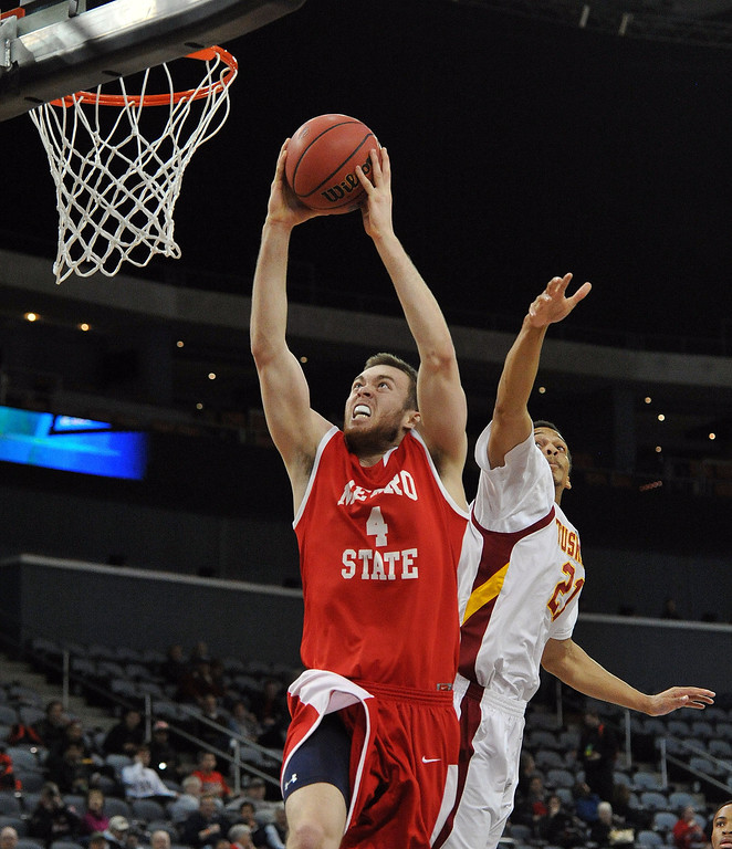 . Metro Stateís Nicholas Kay (4) throws down a dunk while getting past Tuskegeeís Elliot Dean during the first half of the NCAA Div. II quarterfinals of the Elite Eight menís basketball tournament at the Ford Center in Evansville, Ind., Wednesday, March 26, 2014.  (AP Photo/The Evansville Courier & Press, Jason Clark)