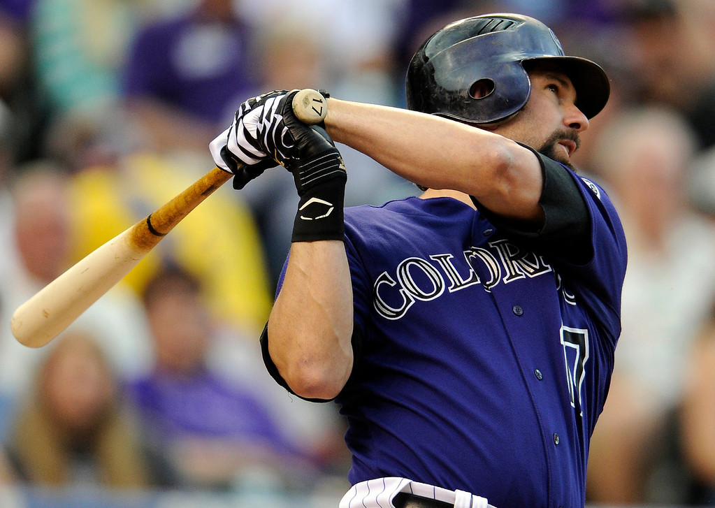 . Colorado Rockies first baseman Todd Helton (17) watches the ball after making contact against the San Diego Padres during their game at Coors Field on Monday, June 13, 2011. AAron Ontiveroz, The Denver Post