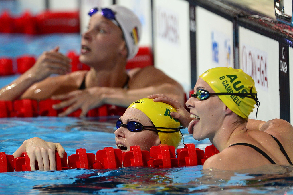 . Australia\'s Bronte Campbell (R) and Australia\'s Cate Campbell react after the semi-finals of the men\'s 50-metre freestyle swimming event in the FINA World Championships at Palau Sant Jordi in Barcelona on August 3, 2013.  LLUIS GENE/AFP/Getty Images