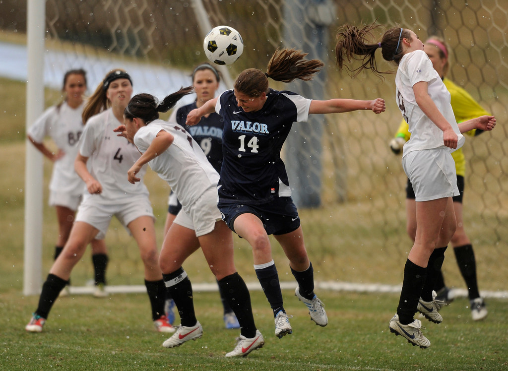 . PARKER, CO. - APRIL 2: Eagles junior midfielder  Jamie Camplese (14) came up to play the ball off a corner kick in the first half Wednesday night. The Valor Christian High School girl\'s soccer team defeated Golden 4-1 Wednesday night, April 3, 2013.  Photo By Karl Gehring/The Denver Post)