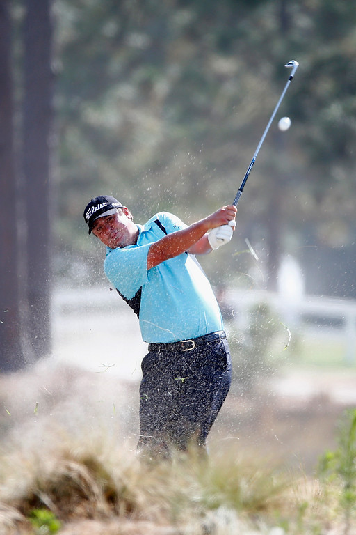 . Jason Dufner of the United States hits a shot from the natural habitat during the first round of the 114th U.S. Open at Pinehurst Resort & Country Club, Course No. 2 on June 12, 2014 in Pinehurst, North Carolina.  (Photo by Sam Greenwood/Getty Images)