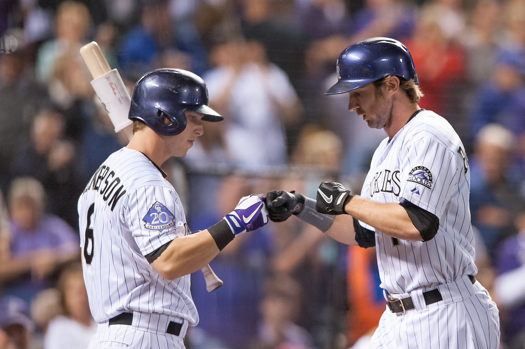 . DENVER, CO - SEPTEMBER 20:  Corey Dickerson #6 of the Colorado Rockies congratulates Charlie Blackmon #19 after Blackmon hit a sixth-inning home run against the Arizona Diamondbacks at Coors Field on September 20, 2013 in Denver, Colorado. Dickerson would homer in the subsequent at bat. (Photo by Dustin Bradford/Getty Images)