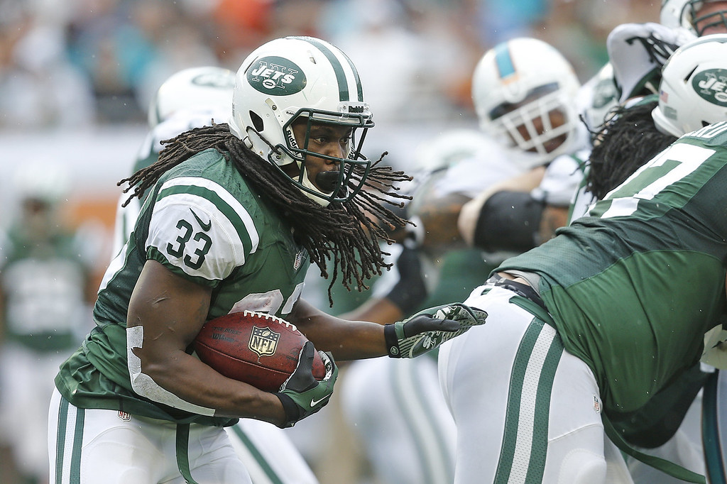 . Chris Ivory #33 of the New York Jets runs with the ball against the Miami Dolphins during first quarter action on December 29, 2013 at Sun Life Stadium in Miami Gardens, Florida. (Photo by Joel Auerbach/Getty Images)